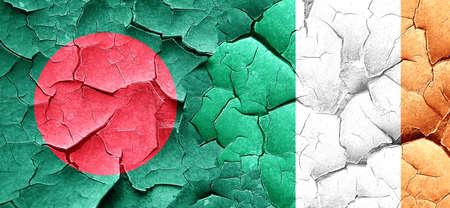 bangladesh: Bangladesh flag with Ireland flag on a grunge cracked wall