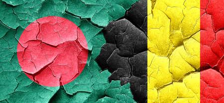 grunge flag: Bangladesh flag with Belgium flag on a grunge cracked wall Stock Photo