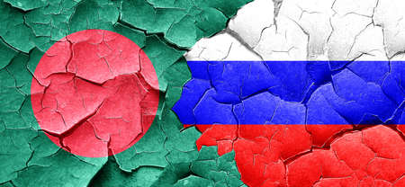 russian flag: Bangladesh flag with Russia flag on a grunge cracked wall Stock Photo