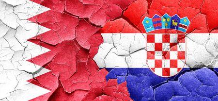 bandera croacia: bandera de Bahrein con la bandera de Croacia en una pared agrietada grunge