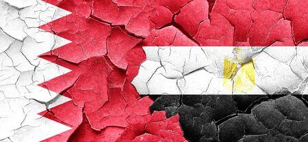 bandera egipto: Bahrain flag with egypt flag on a grunge cracked wall