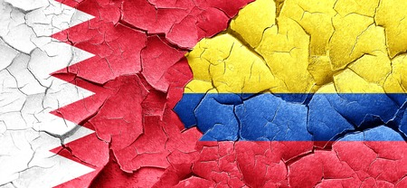 cracked wall: Bahrain flag with Colombia flag on a grunge cracked wall Stock Photo