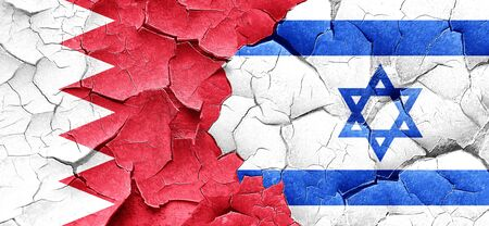 israel flag: Bahrain flag with Israel flag on a grunge cracked wall