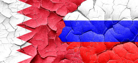 cracked wall: Bahrain flag with Russia flag on a grunge cracked wall