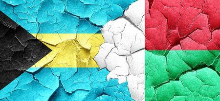 bahamas: Bahamas flag with Madagascar flag on a grunge cracked wall