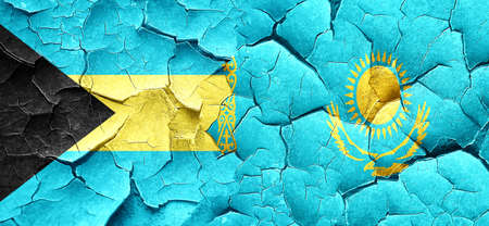 cracked wall: Bahamas flag with Kazakhstan flag on a grunge cracked wall