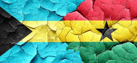 ghanese: Bahamas flag with Ghana flag on a grunge cracked wall Stock Photo