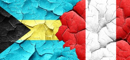 bahamas: Bahamas flag with Peru flag on a grunge cracked wall