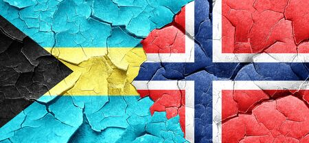 norway flag: Bahamas flag with Norway flag on a grunge cracked wall Stock Photo