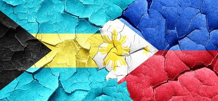 bahamas: Bahamas flag with Philippines flag on a grunge cracked wall