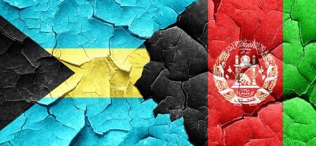 bahamas: Bahamas flag with afghanistan flag on a grunge cracked wall