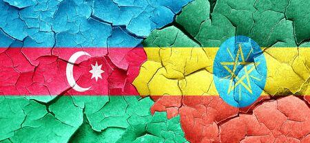 cracked wall: Azerbaijan flag with Ethiopia flag on a grunge cracked wall Stock Photo