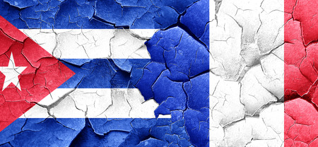 bandera cuba: Cuba flag with France flag on a grunge cracked wall Foto de archivo