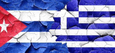 flag of cuba: Cuba flag with Greece flag on a grunge cracked wall
