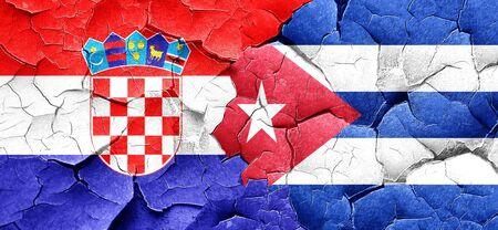 bandera de croacia: Bandera de Croacia con la bandera de cuba en una pared agrietada grunge Foto de archivo