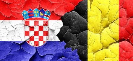 bandera croacia: Bandera de Croacia con la bandera de Bélgica en una pared agrietada grunge Foto de archivo