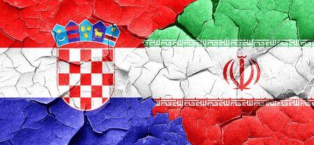 bandera de croacia: Bandera de Croacia con la bandera de Irán en una pared agrietada grunge Foto de archivo