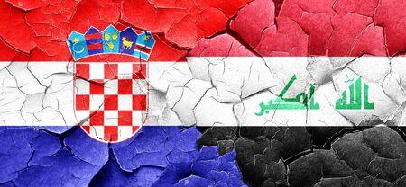 bandera croacia: croatia flag with Iraq flag on a grunge cracked wall