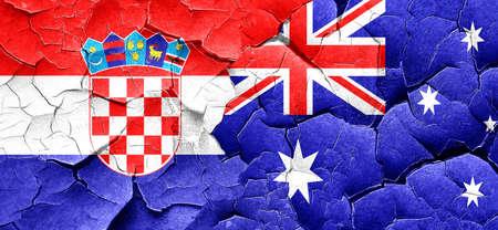 bandera croacia: Bandera de Croacia con la bandera de Australia en una pared agrietada grunge Foto de archivo