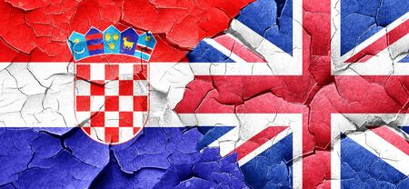 british culture: croatia flag with Great Britain flag on a grunge cracked wall Stock Photo