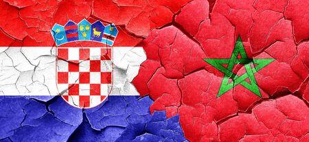 croatia flag: croatia flag with Morocco flag on a grunge cracked wall Stock Photo