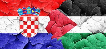 croatia flag: croatia flag with Palestine flag on a grunge cracked wall Stock Photo