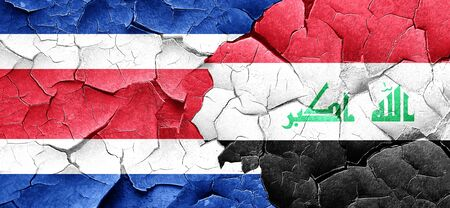 iraq conflict: Costa Rica flag with Iraq flag on a grunge cracked wall