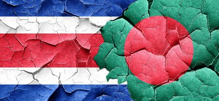 costa rican flag: Costa Rica flag with Bangladesh flag on a grunge cracked wall