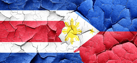 philippino: Costa Rica flag with Philippines flag on a grunge cracked wall