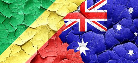 cracked wall: Congo flag with Australia flag on a grunge cracked wall Stock Photo