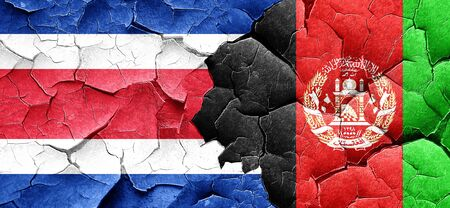 costa rican flag: Costa Rica flag with afghanistan flag on a grunge cracked wall