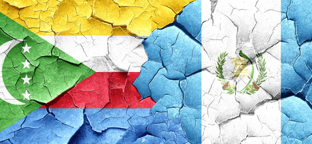 guatemalan: Comoros flag with Guatemala flag on a grunge cracked wall