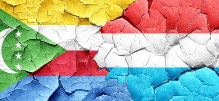 comoros: Comoros flag with Luxembourg flag on a grunge cracked wall Stock Photo
