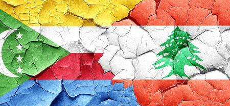 comoros: Comoros flag with Lebanon flag on a grunge cracked wall