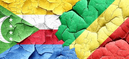 comoros: Comoros flag with congo flag on a grunge cracked wall