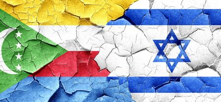 cracked wall: Comoros flag with Israel flag on a grunge cracked wall