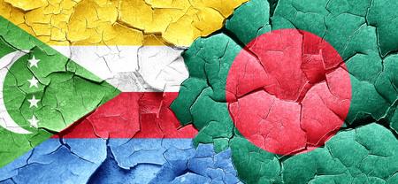 bangladesh: Comoros flag with Bangladesh flag on a grunge cracked wall Stock Photo