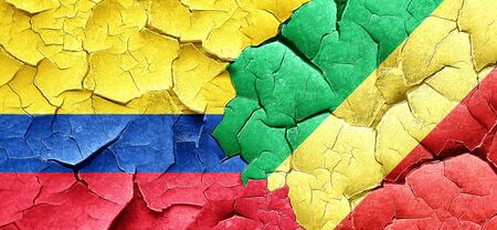 bandera de colombia: Colombia flag with congo flag on a grunge cracked wall