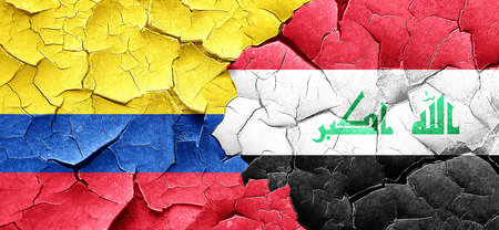 iraq conflict: Colombia flag with Iraq flag on a grunge cracked wall Stock Photo