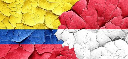 cracked wall: Colombia flag with Indonesia flag on a grunge cracked wall Stock Photo