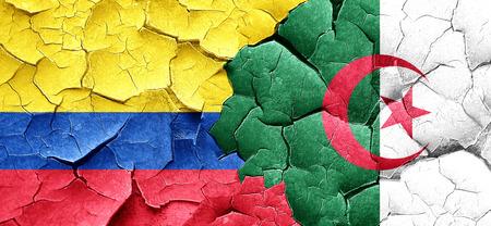 bandera de colombia: Colombia flag with Algeria flag on a grunge cracked wall Foto de archivo