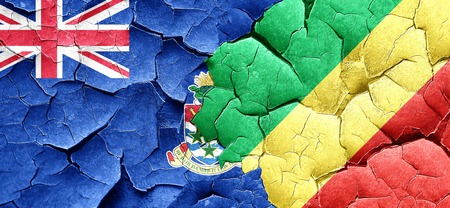cayman: cayman islands flag with congo flag on a grunge cracked wall Stock Photo