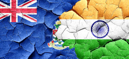 cayman: cayman islands flag with India flag on a grunge cracked wall Stock Photo