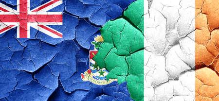 cayman: cayman islands flag with Ireland flag on a grunge cracked wall