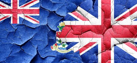 cayman islands: cayman islands flag with Great Britain flag on a grunge cracked wall