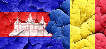 romania flag: Cambodia flag with Romania flag on a grunge cracked wall