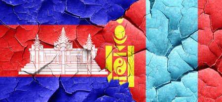 mongolia: Cambodia flag with Mongolia flag on a grunge cracked wall