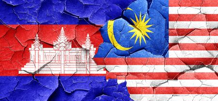 cracked wall: Cambodia flag with Malaysia flag on a grunge cracked wall
