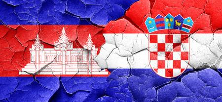 bandera croacia: Cambodia flag with Croatia flag on a grunge cracked wall Foto de archivo