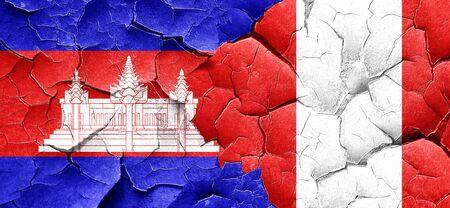 bandera peru: Cambodia flag with Peru flag on a grunge cracked wall